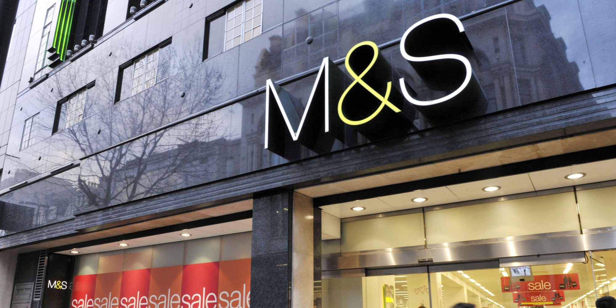Shoppers outside Marks and Spencer on Oxford Street, London, as two of the UK's biggest retailers opened their stores to post-Christmas bargain hunters today as figures showed a big rise in shoppers on the streets.