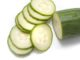 Freshly sliced cucumber for use as a salad ingredient in a health diet on a white background